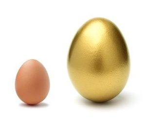 image of a normal egg and a golden egg